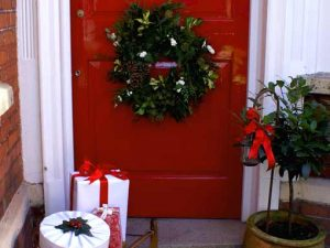 Image of a christmas wreath on a front door to illustrate a christmas wreaths workshop