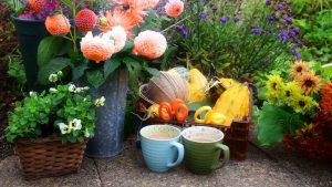 Image of cups of tea with floral arrangements and gardening items