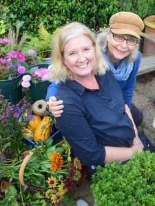 Double portrait in a garden with floral arrangements. Garden courses and floral courses in somerset wiltshire bristol and bath